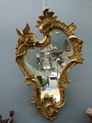 A gilded mirror with a dragon