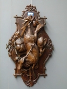 A highly carved wooden hunting panel.