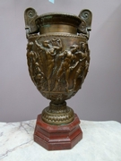 A bronze vase on red marble base by Barbiedienne.