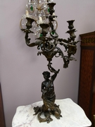 A gilded and patinated bronze candelabra by Pandiani a Milano.