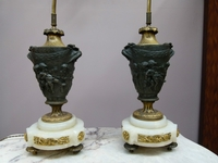 A pair bronze gilded and patinated lamps.