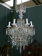 A bronze silverplated  and crystal lamp.