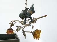 A bronze lamp with a putto.