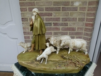 A Royal Dux groupe of a shepherd with his dog and sheep.